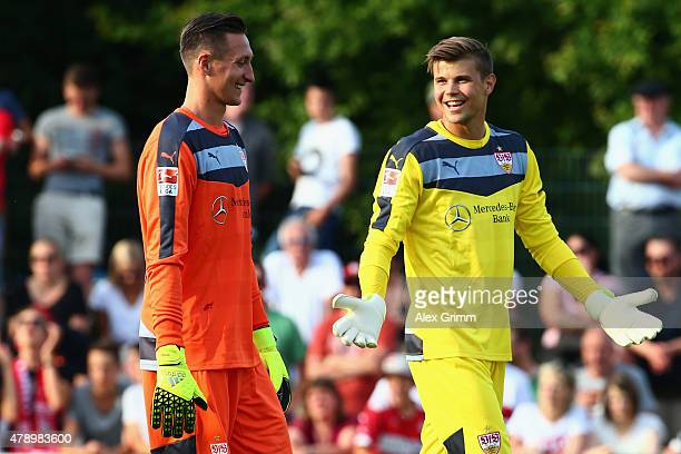 New goalkeepers Mitch Langerak and Przemyslaw Tyton chat during the first training session of VfB Stuttgart at Robert-Schlienz-Stadion on June 29,...
