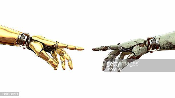 New golden robot hand points to aged rusting hand