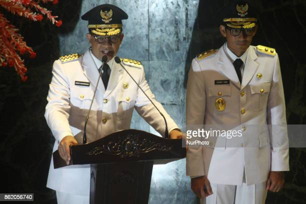 New Governor of Jakarta Anies Baswedan and new Vice Governor of Jakarta Sandiaga Salahudin Uno give a first speech after handover the Governor's...