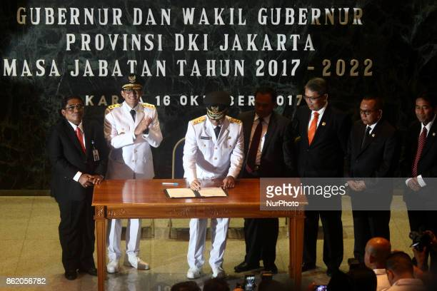 New Governor of Jakarta Anies Baswedan and new Vice Governor of Jakarta Sandiaga Salahudin Uno handover the Governor's position represented by daily...