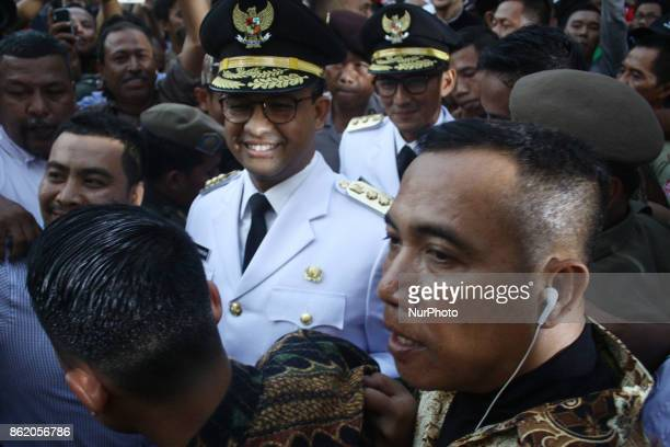 New Governor of Jakarta Anies Baswedan and new Vice Governor of Jakarta Sandiaga Salahudin Uno arrived at Jakarta City Hall to handover the...