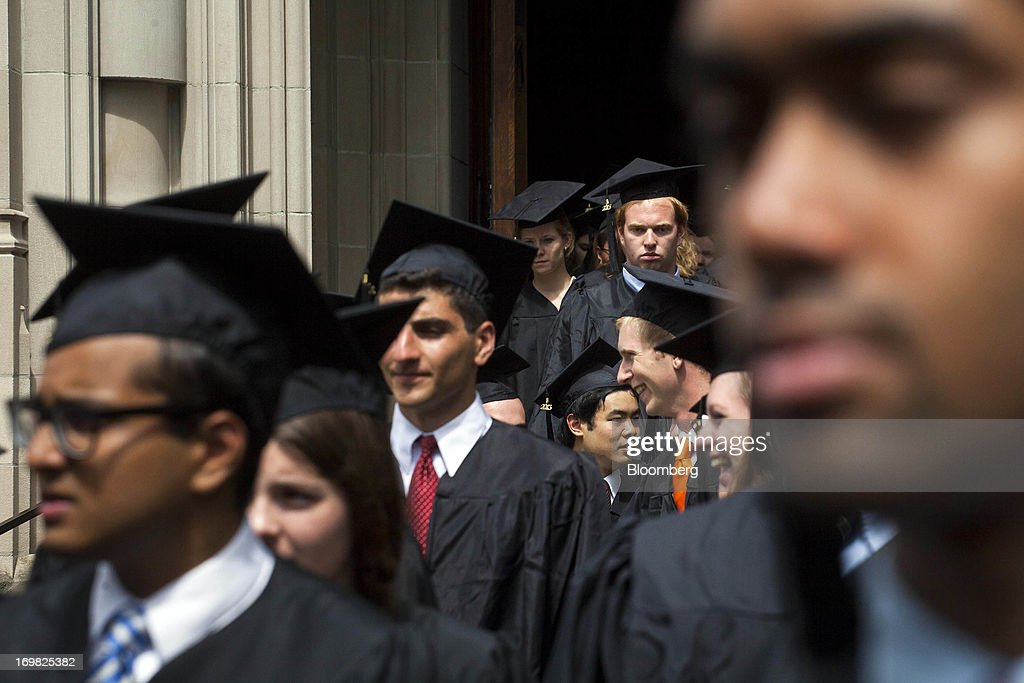 New graduates walk out of the chapel after their commencement at Princeton University in Princeton, New Jersey, U.S., on Sunday, June 2, 2013. Ben S. Bernanke, chairman of the U.S. Federal Reserve, returning to the Princeton University campus where he taught economics for 17 years, offered graduating seniors often humorous advice on subjects ranging from love and success to money and politics in a speech that quoted St. Luke, Lily Tomlin and Forrest Gump. Photographer: Michael Nagle/Bloomberg via Getty Images