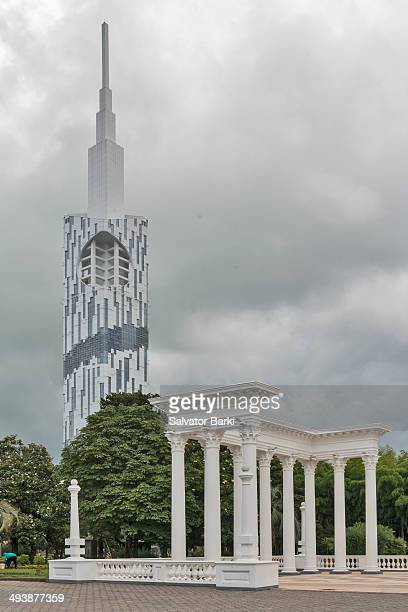 CONTENT] New Greeek temple style coloumns in Batumi public park with Batumi University building in the background seen from Batumi municipal park