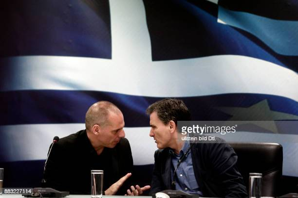 New Greek Finance minister Euclid Tsakalotos with outgoing Minister Yanis Varoufakis at the ministry in Athens on July 6 2015
