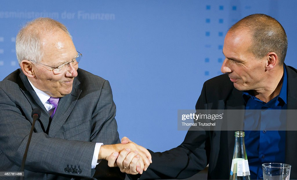 New Greek Finance Minister Yanis Varoufakis (R) and German Finance Minister Wolfgang Schaeuble shake hands after a press conference on February 05, 2014 in Berlin, Germany. Varoufakis is touring several European cities and yesterday met with Mario Draghi at the European Central Bank following announcements by the new Greek government to sharply alter its relationship with the troika of loan-giving entities.