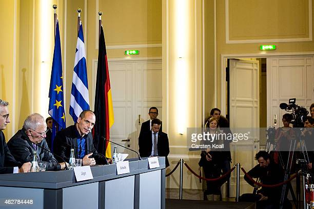 New Greek Finance Minister Yanis Varoufakis and German Finance Minister Wolfgang Schaeuble speak to the media following talks on February 5 2015 in...