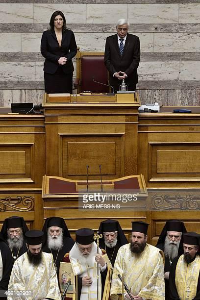 New Greek President Prokopis Pavlopoulos looks on after swearing the oath of office during a swearingin ceremony at Parliament in Athens on March 13...