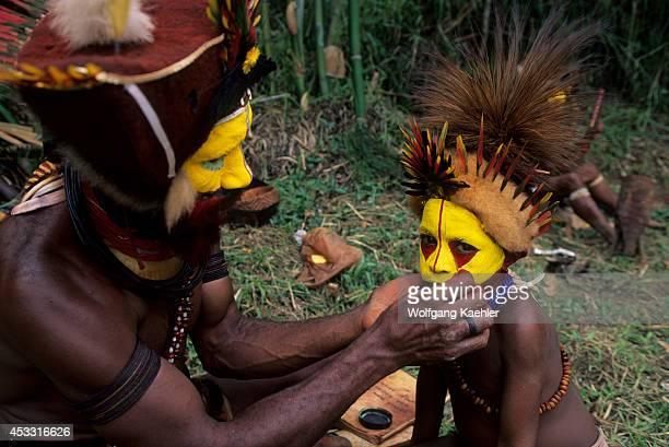 New Guinea Highlands, Near Tari, Huli Tribe, Wigmen, Father Decorating Son For Dances.
