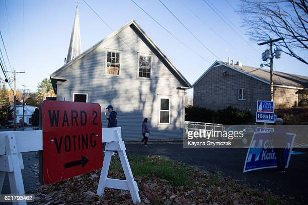 New Hampshire citizens vote at the West Congregational Church on November 8 in Concord New Hampshire Americans today will choose between Republican...