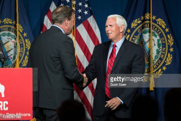 New Hampshire Governor Chris Sununu and former Vice President Mike Pence shake hands during the GOP Lincoln-Reagan Dinner on June 3, 2021 in...