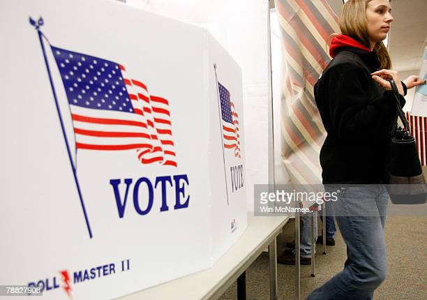 New Hampshire resident leaves a voting booth after casting her vote in the New Hampshire presidential primary at the Ward 3 Carol M Rines Center...