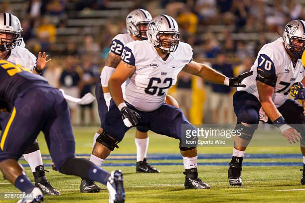 New Hampshire Wildcats offensive lineman George Kallas blocks at the line of scrimmage during game action between the New Hampshire Wildcats, of the...