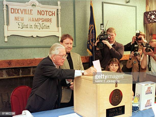 New Hampshire's oldest resident and town moderator Neil Tillotson who is 101 years old casts the first ballot in the 2000 primary elections in...