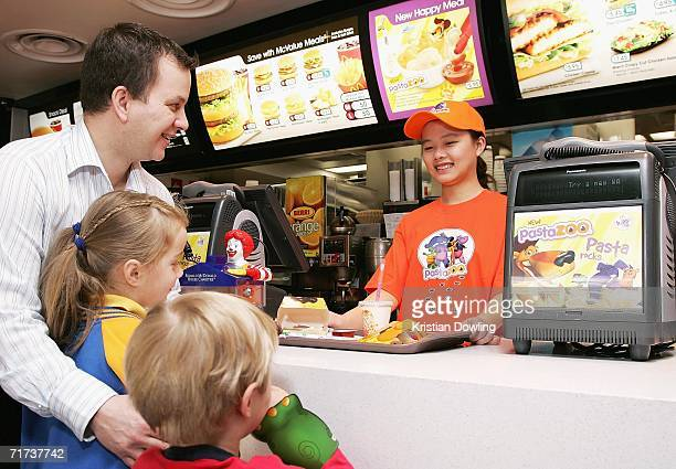 A new Happy Meal is served to customers at the McDonald's restaurant in Collingwood on August 29 2006 in Melbourne Australia The new Happy Meal is a...