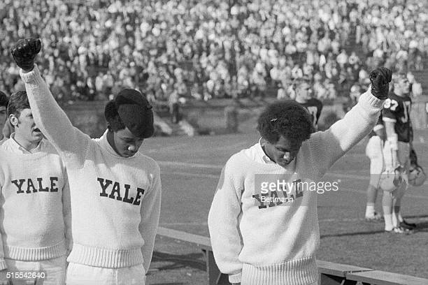 Yale cheer leaders Greg Parker and Bill Brown give the Black Power salute during the National Anthem starting the YaleDartmouth football game in the...