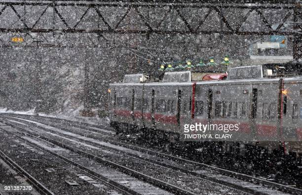 New Haven Line Metro North train makes its way around a turn at the Metro North Station in Greenwich Connecticut March 13 2018 as New England's third...