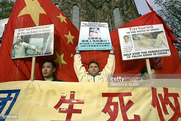 Members of the Falun Gong demonstrate against the visit of China's President Hu Jintao to Yale University in New Haven Connecticut 21 April 2006 The...