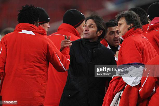 New head coach Bruno Labbadia of Stuttgart celebrates with team members after the UEFA Europa League group H match between VfB Stuttgart and Odense...