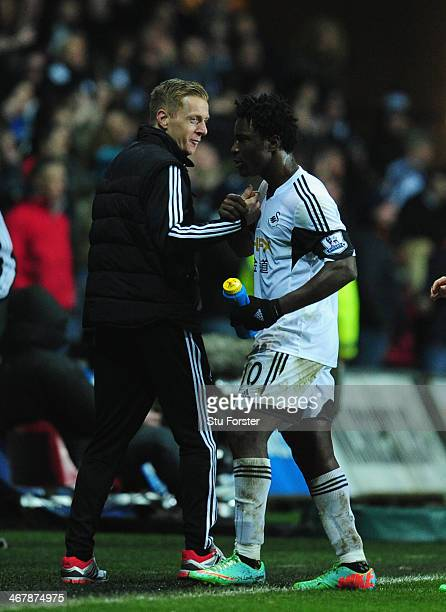 New head coach Garry Monk celebrates with goalscorer Wilfried Bony after the Barclays Premier League match between Swansea City and Cardiff City at...