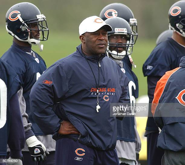 New head coach Lovie Smith of the Chicago Bears watches his team go through drills during the morning practice at mini-camp on April 30, 2004 at...