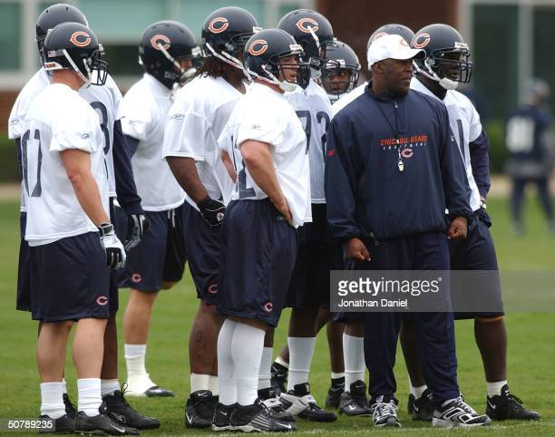 New head coach Lovie Smith of the Chicago Bears watches with members of the defense as his team goes through drills during the morning practice at...