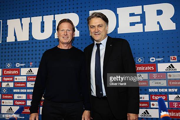 New Head Coach Markus Gisdol and CEO Dietmar Beiersdorfer of Hamburger Sport Verein poses during the press conference at Volksparkstadion on...