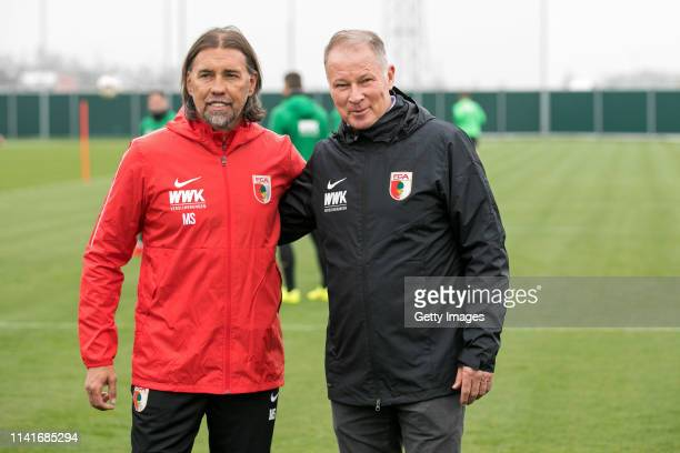 New head coach of FC Augsburg Martin Schmidt and Augsburgs managing director Stefan Reuter are seen during Schmidts first training session at...