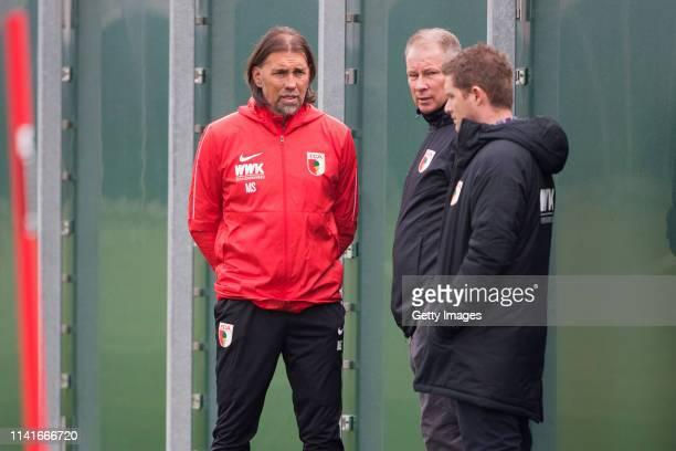 New head coach of FC Augsburg Martin Schmidt Augsburgs managing director Stefan Reuter and Augsburgs Head of Media Public Relations Dominik Schmitz...
