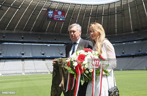 New head coach of FC Bayern Muenchen Carlo Ancelotti presents his new traditional Bavarian leather trousers he received as present together with his...
