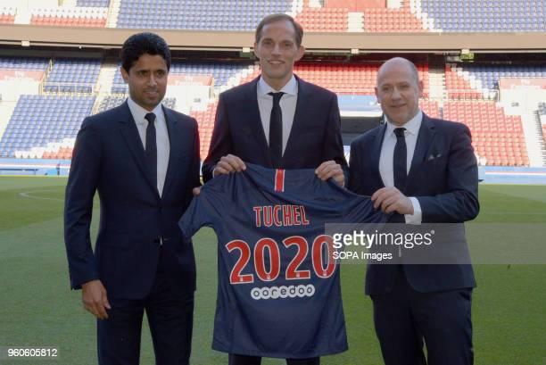 New head coach of PSG Thomas Tuchel PSG president Nasser Al Khelaifi and Antero Henrique seen during the press conference of Paris Saint Germain at...