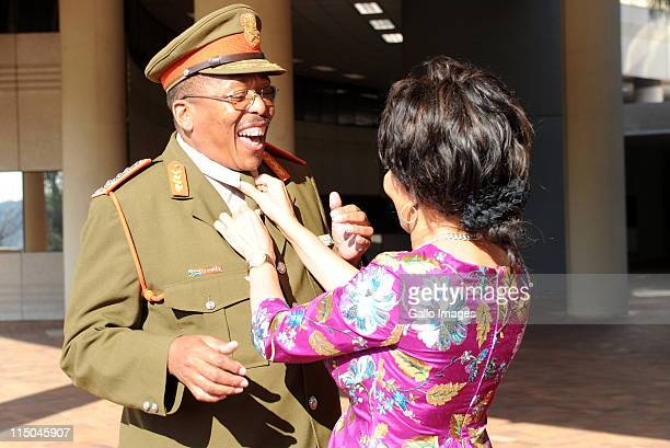 New head of the South African national army Lieutenant General Solly Shoke has his tie corrected by Minister of Defence Lindiwe Sisulu at the...