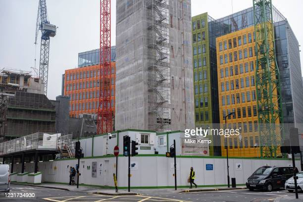 New high rise construction site just behind the Google office headquarters on 3rd March 2021 in London, England, United Kingdom. Google is an...