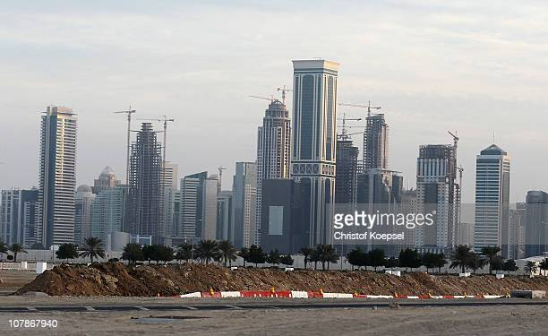 New highrise office buildings and hotels still under construction stand in the new City Center and West Bay district on January 4 2011 in Doha Qatar...
