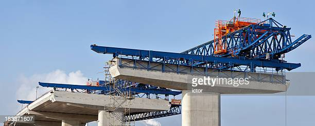 new highway bridge under construction - crane construction machinery stock pictures, royalty-free photos & images