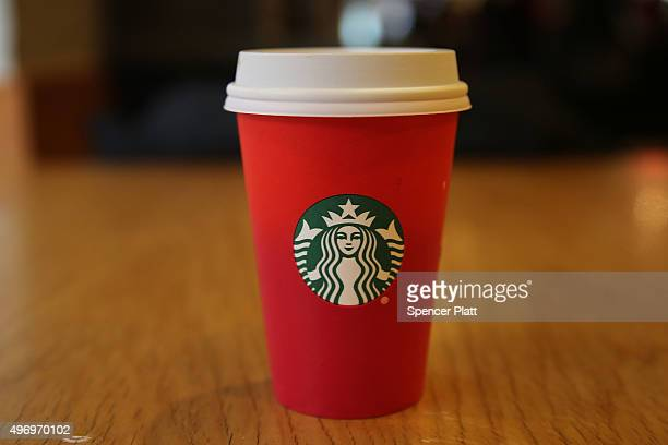 A new holiday Starbucks cup is viewed on November 12 2015 in New York City The coffee giant has come under criticism by some for leaving any...