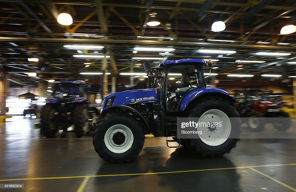 A New Holland T7 tractor drives through the factory at CNH