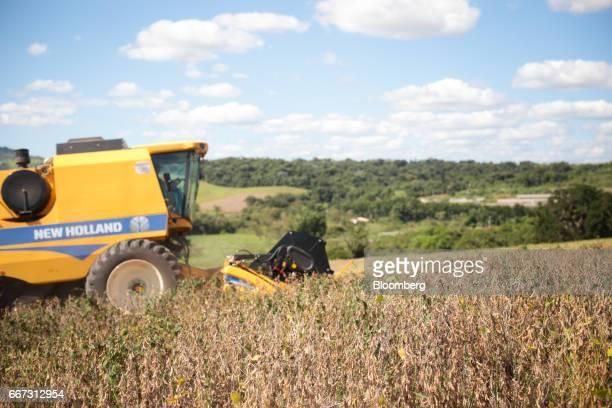 A New Holland Tractor Ltd combine machine harvests soybeans at the Santa Cruz farm near Atibaia Brazil on Wednesday March 29 2017 Brazil is world's...
