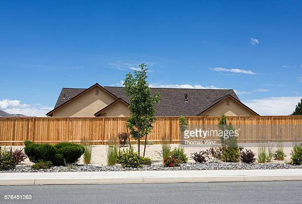 new home and fence - street stock pictures, royalty-free photos & images