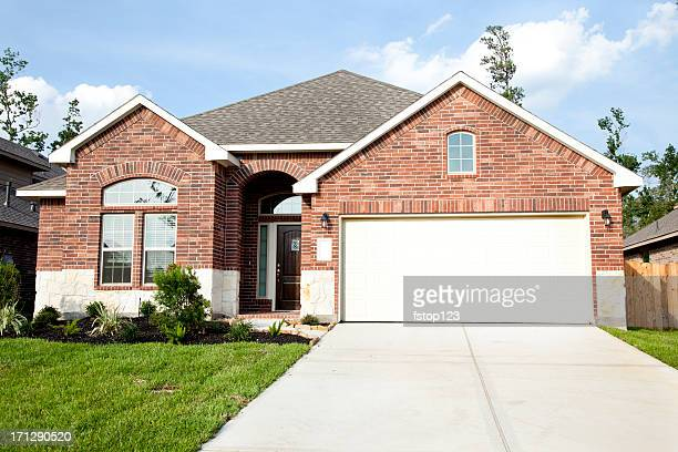 new home construction in growing subdivision - brick house stock pictures, royalty-free photos & images