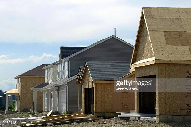 New home construction is booming 21 July 2003 in Naperville, IL, a suburb of Chicago. The index of leading US economic indicators rose 0.1 percent in...