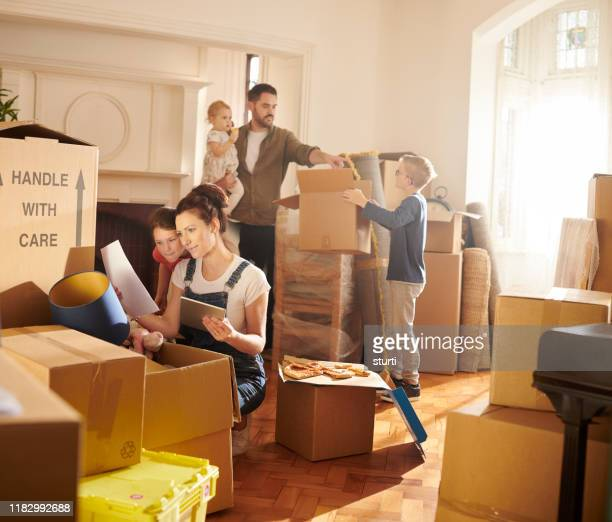 new home finances - unpacking stock pictures, royalty-free photos & images