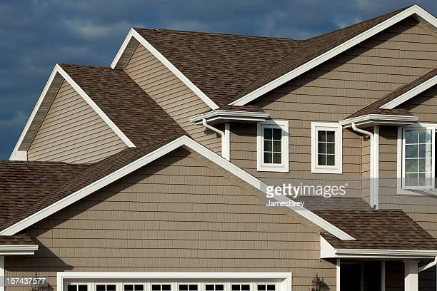 new home, vinyl siding, architectural asphalt shingle roof, real estate - roof stock photos and pictures