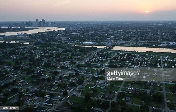 New homes are mixed with old homes and vacant lots in the Lower Ninth Ward in front of the Industrial Canal and downtown New Orleans on August 24...
