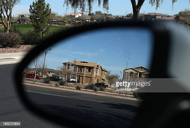 New homes are under construction at a housing development on March 6 2013 in Gilbert Arizona In 2008 Phoenix Arizona was at the forefront of the US...