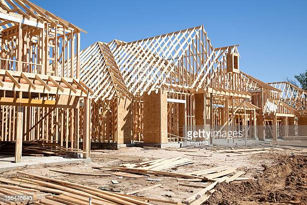 New homes construction site. Framed houses. Lumber. Building.