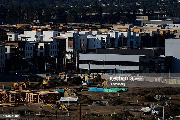 New homes stand next to shopping centers and apartments under construction at the Playa Vista community development in Los Angeles California US on...