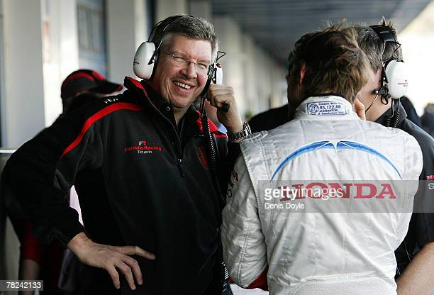 New Honda team pricipal Ross Brawn of Britain chats with fellow countryman and Honda driver Jenson Button during Formula One Testing at the Circuito...