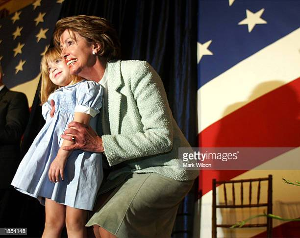 New House Democratic leader Nancy Pelosi hugs her granddaughter during her swearing in ceremony January 7 2003 on Capitol Hill in Washington DC This...