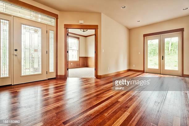 New house interior entrance hardwood floors natural light filled