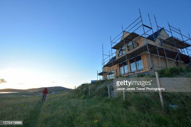 new house with scaffolding being built on the coast - modern stock pictures, royalty-free photos & images